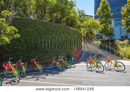 Mountain View, California, United States - August 15, 2016: colorful bikes used by Google employees to move around the Google headquarters, also called Googleplex. Google bicycle in its campus.