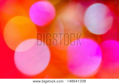 Abstract Christmas background with a colorful bokeh.