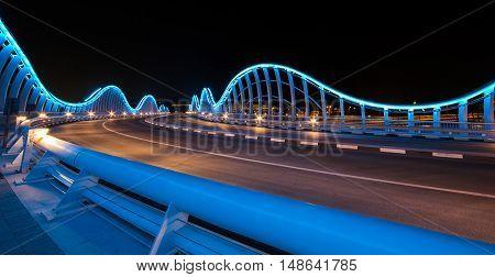 Dubai UAE 23rd September 2016: Meydan bridge outside Meydan race track illuminated at night