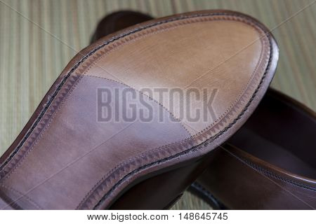 Footwear Concepts. Backside View of Penny Loafer Natural Leather Sole. Horizontal Image