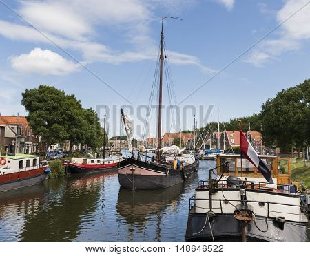 Enkhuizen The Netherlands - August 9 2016: Old ship in the harbor in Enkhuizen in The Netherlands.