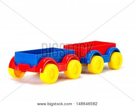 Toy trailer with yellow wheels on a white background