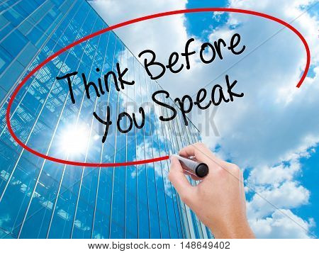 Man Hand Writing Think Before You Speak With Black Marker On Visual Screen