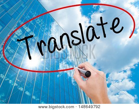 Man Hand Writing Translate With Black Marker On Visual Screen
