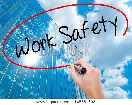 Man Hand Writing Work Safety With Black Marker On Visual Screen