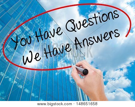 Man Hand Writing You Have Questions We Have Answers With Black Marker On Visual Screen