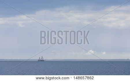 Sailing ship (flatbottem) on IJsselmeer near Marken in The Netherlands
