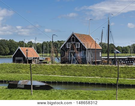 Enkhuizen The Netherlands - August 9 2016: Zuiderzee Museum Enkhuizen with old fisherman house fishing gear and boat in The Netherlands.