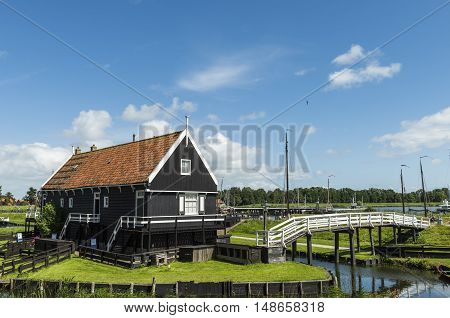 Enkhuizen The Netherlands - August 9 2016: Zuiderzee Museum Enkhuizen with old fisherman house and white bridge in The Netherlands.