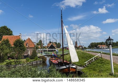 Enkhuizen The Netherlands - August 9 2016: Zuiderzee Museum Enkhuizen with old fisherman house sailing boat and small town in The Netherlands.