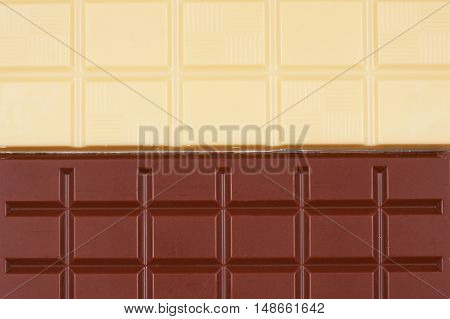 White and milk chocolate abstract background. Concept of yin and yang made of sweets.