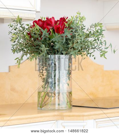 the beautiful flower arrangement in clear glass vase