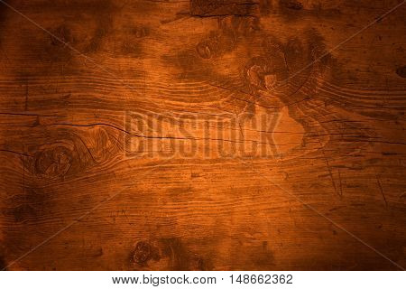 Wood texture in sunlight rays view from above