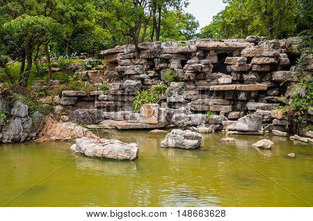 Asian rocky pond zen garden, inside a  park in china