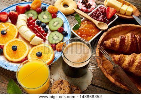 Breakfast buffet healthy continental coffee orange juice fruit salad croissant