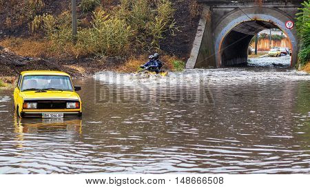 Odessa, Ukraine - September 20, 2016: Driving Cars On A Flooded Road During Flooding Caused By Torre
