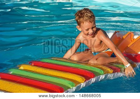 Cute Boy Swimming In Pool Water.