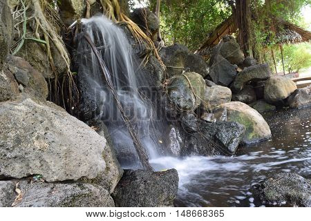 fountain stream landscaping with rocks in garden