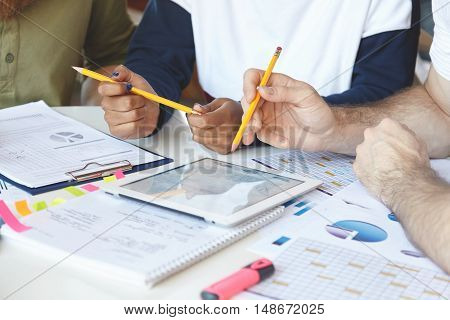 Group Of Office Workers Holding Pencils, Working Together On Financial Report, Studying Statistics,