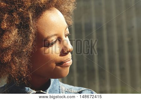 Highly-detailed Shot Of Beautiful Happy African Female With Healthy Perfect Skin And Facial Piercing