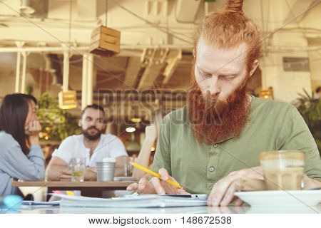 People And Technology. Redhead Freelancer With Concentrated Look Using Touch Pad For Distant Work, S