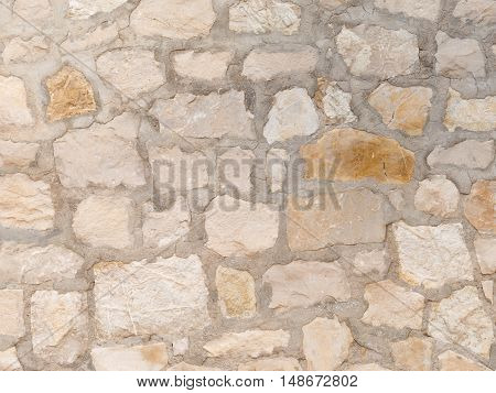 Exterior light Decorative old rough wall made of natural sandstone with potholes and streaks in country style