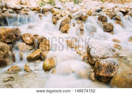 Rio Chillar River In Nerja, Malaga, Spain. Flowing Water Washes Stones. Long Exposure.