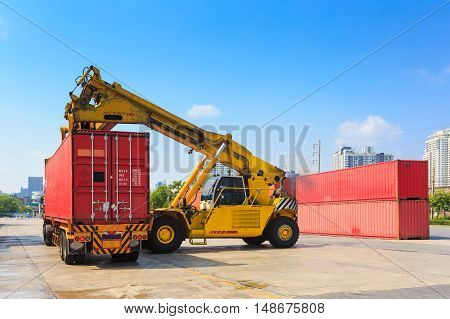 Cargo containers and folklift in shipping yard for import,export industrial