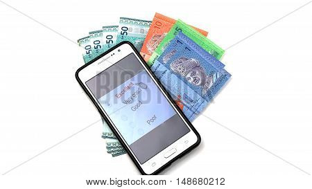 smart phone and malaysia cash. Online shopping consept. on white backgroundonline business consept