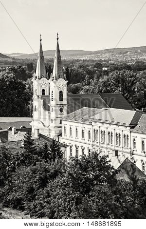Saint Ignatius church view from Esztergom basilica Hungary. Travel destination. Cultural heritage. Urban scene. Religious architecture. Black and white photo. Danube river.