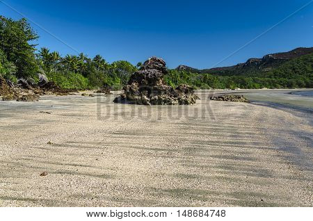 A rock formation on a beach in tropical Queensland.