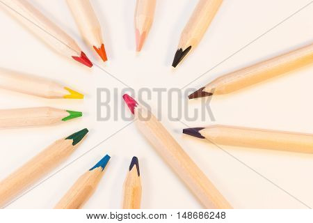 Crayons in a circle with one crayon in the middle