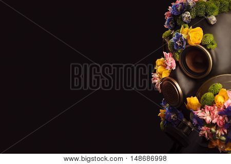 Portrait Of Woman With Flowers Growing Through Respirator Mask