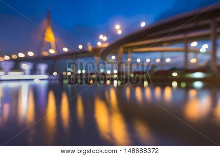 Blurred bokeh suspension bridge river front night view