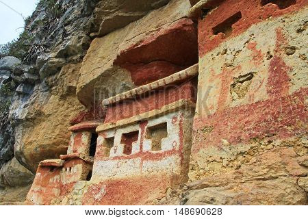 Pre inca mausoleum Revash in the mountains of northern Peru. Famous for the built in the wall and for the colorfull red and brown paintings.