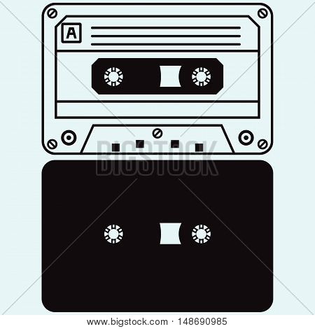 Cassette tape. Isolated on blue background. Vector silhouettes