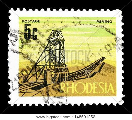 RHODESIA - CIRCA 1970 : Cancelled postage stamp printed by Rhodesia, that shows Mining.