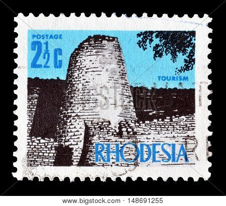 RHODESIA - CIRCA 1970 : Cancelled postage stamp printed by Rhodesia, that shows Ruins in Zimbabwe.