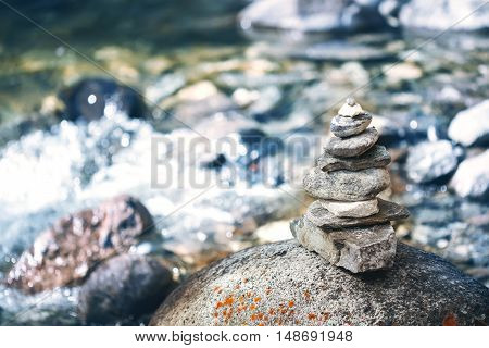 Stone pyramid cairn near river buddhism tradition zen harmony