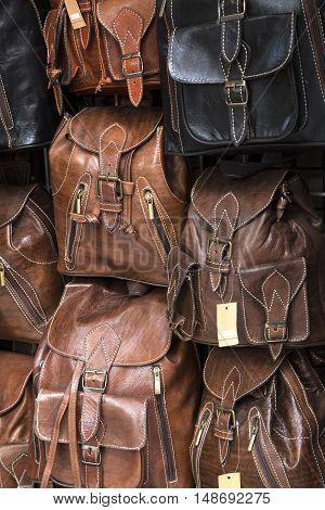 Leather back packs on a street market