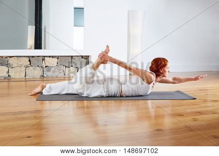Yoga exercise in wooden floor gym and mirror indoor