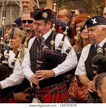 MOSCOW, RUSSIA - September 4, 2016: Pipers of Celtic pipes and drums band surrounded by townspeople in the Park of arts