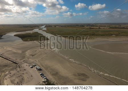 View of the road leading to Mont Saint Michel France at low tide