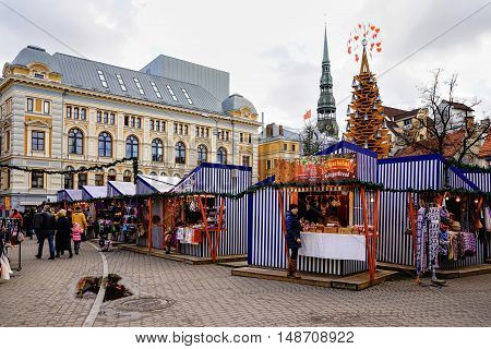 People At Riga Christmas Market With St Peter Church Spire