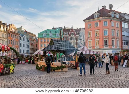 People Walking Near Christmas Market At Riga Cathedral Square