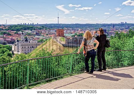Women Taking Photo Of Gediminas Tower And Lower Castle Vilnius