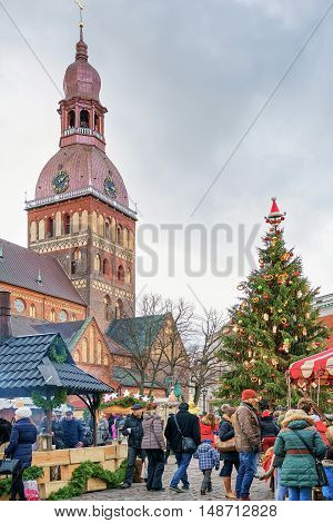 People Enjoy Celebrations At The Christmas Market In Riga
