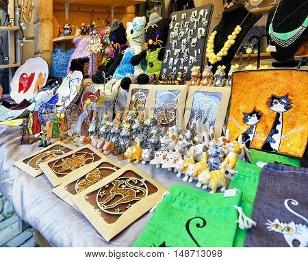 Souvenirs With Cat Symbol Displayed At The Riga Christmas Market