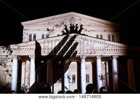 MOSCOW RUSSIA - SEPTEMBER 24 2016: The Circle of Light Moscow international festival. State Academic Bolshoi Theatre of Opera and Ballet illuminated for free open air perfomance.