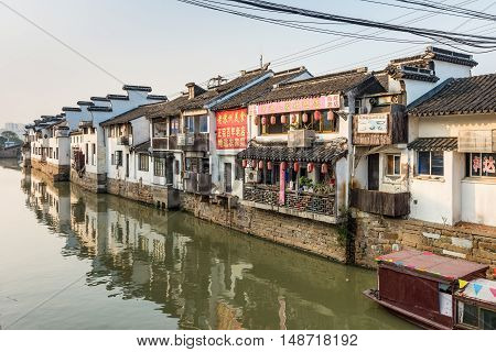 Suzhou China - October 23 2016: Suzhou old town canal and folk houses in Suzhou Jiangsu China. Suzhou is one of the old watertowns in China.